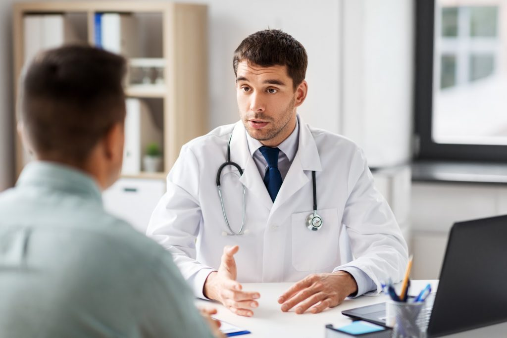 Doctor at stem cell clinic performing a consultation