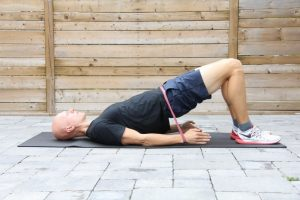 The supported bridge exercise as stretches for lower back pain