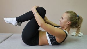 Knee-to-chest stretching